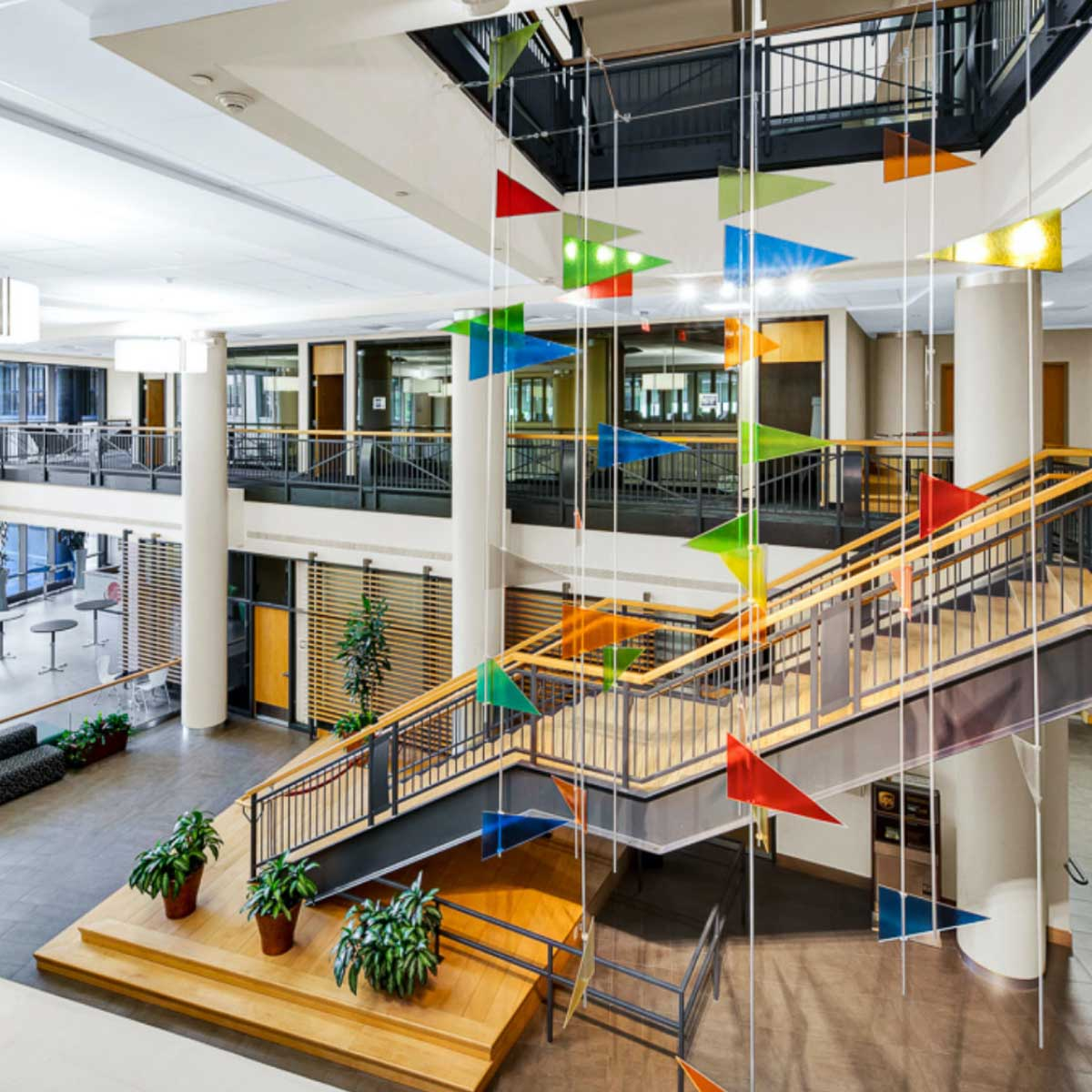 2-story lobby staircase with multi-colored flag art installation